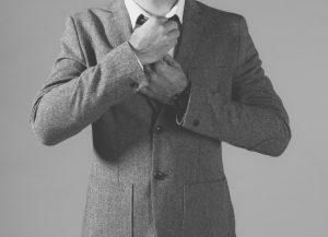 B&W Man In Fashion Jaket Straightening Tie
